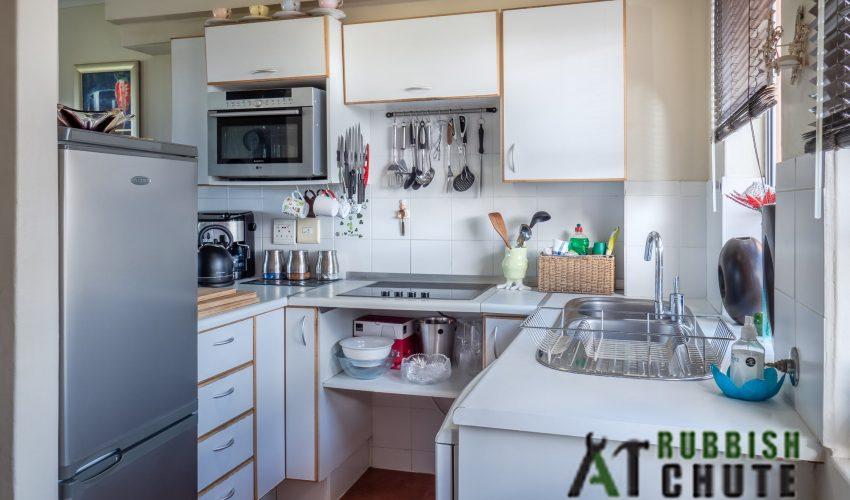 condo-kitchen-hidden-chute_wm